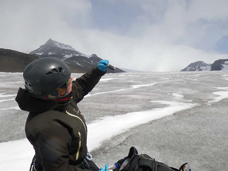Dr Anne D Jungblut takes samples from the glacier