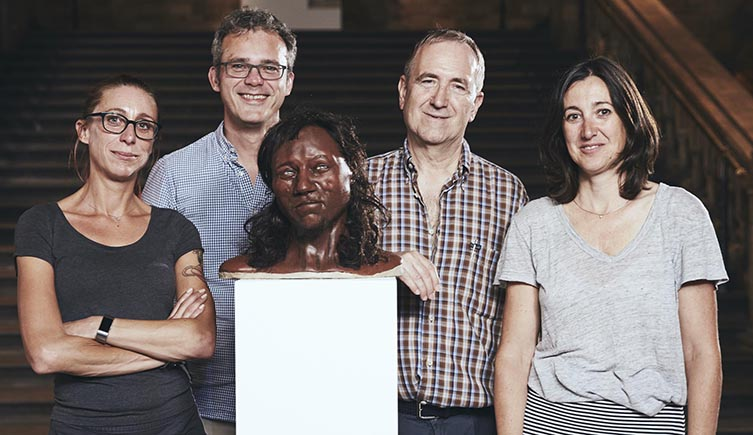 Museum scientists Dr Selina Brace, Prof Ian Barnes, Prof Chris Stringer and Dr Silvia Bello pose with the reconstruction of Cheddar Man.