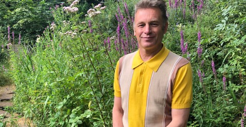 Chris Packham, the vice president of Butterfly Conservation, pictured in the Museum's Wildlife Garden.