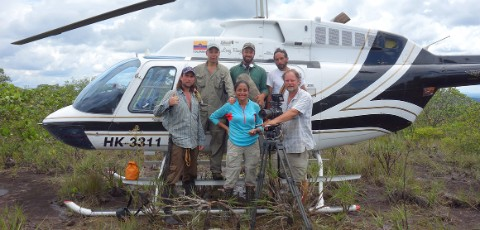 Dr Blanca Huertas and her team with the helicopter which delivered them to the national park