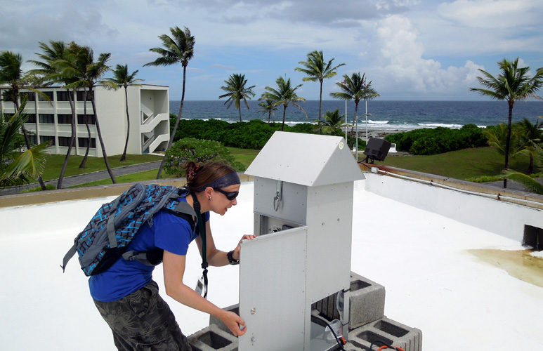 Penny Wozniakiewicz collecting samples from the dust sampler on Kwajalein atoll.