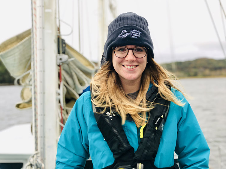 A portrait of Becky Dudley, Marine Biodiversity Officer. Becky studies UK cetaceans, including common dolphins, killer whales and harbour porpoises