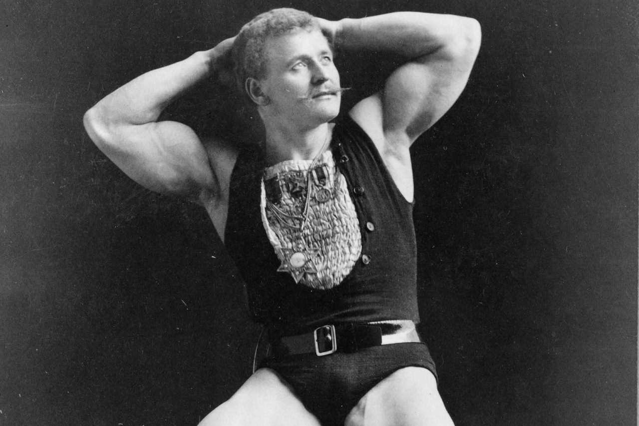 Eugen Sandow sat down with he hands on his head, and the Jewish star of David round his neck