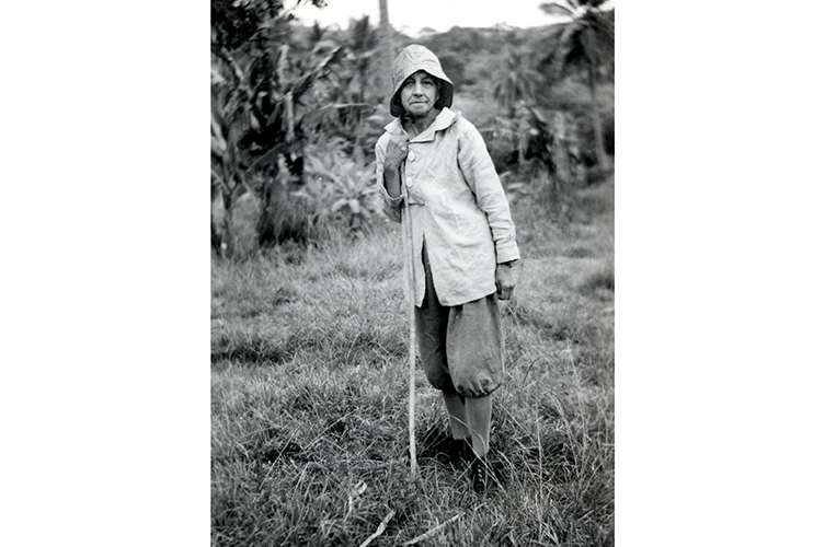 Lucy Evelyn Cheesman in the field wearing sack cloth trousers