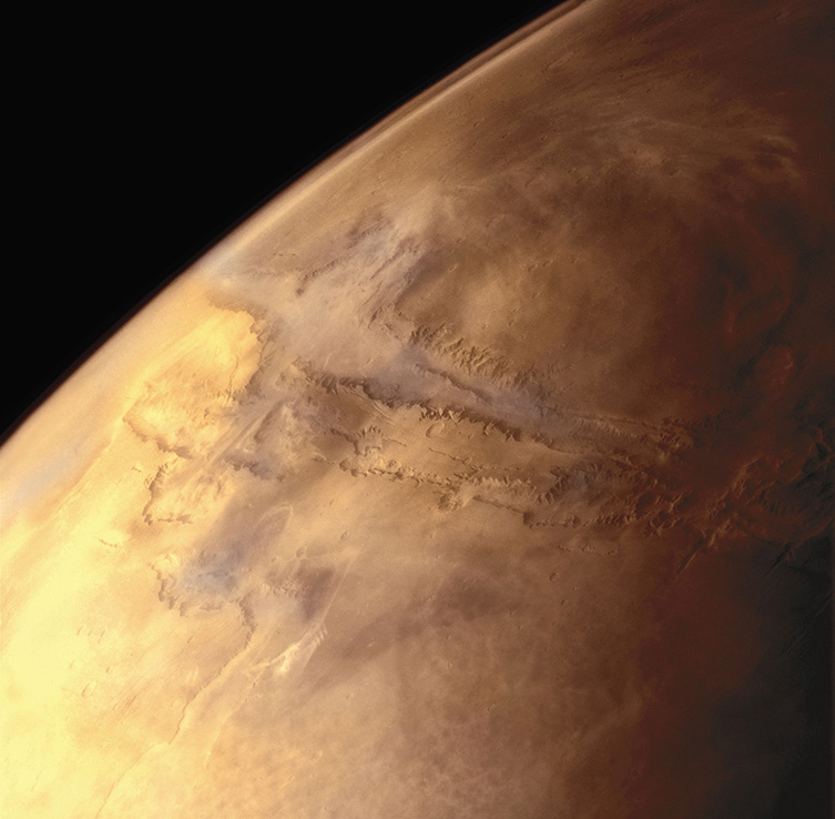 A photograph from space of the Valles Marineris, a huge cross-shaped canyon on the surface of Mars