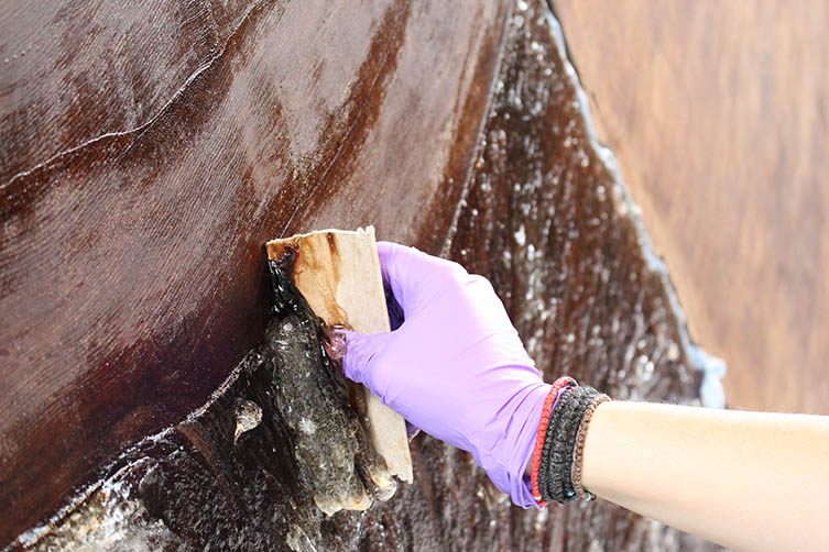 Conservators applying solvent gel to the giant sequoia