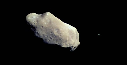 Grey asteroid floating the blackness of space
