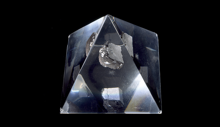 A piece of moon rock in a glass prism