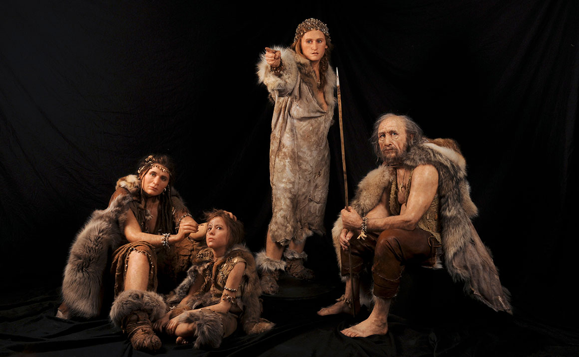 Group of Homo sapiens wearing skins, furs and decorative adornments