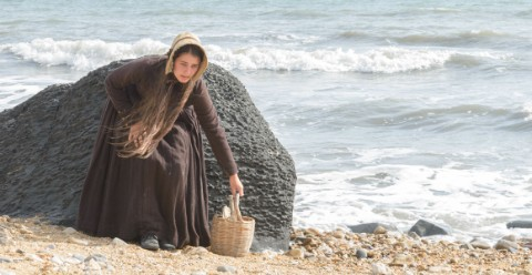 Mary Anning collects fossils on the beach.