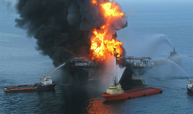 The Deepwater Horizon rig in flames in 2010.