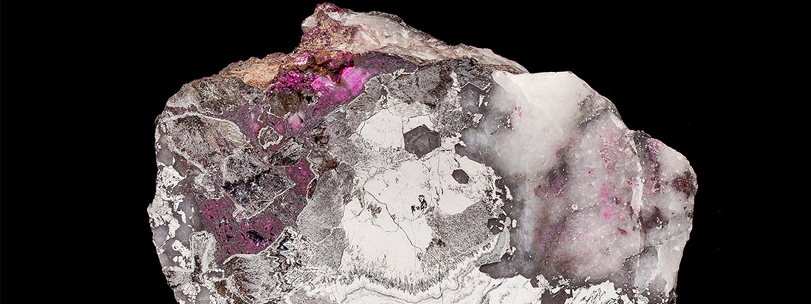 Colloform mass of silver-white skutterudite associated with crimson-pink erythrite.