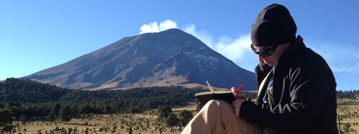 Dr Chiara Petrone taking notes in front of Popocatépetl volcano