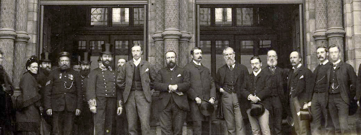 Staff on the front steps of the Museum, 1884.