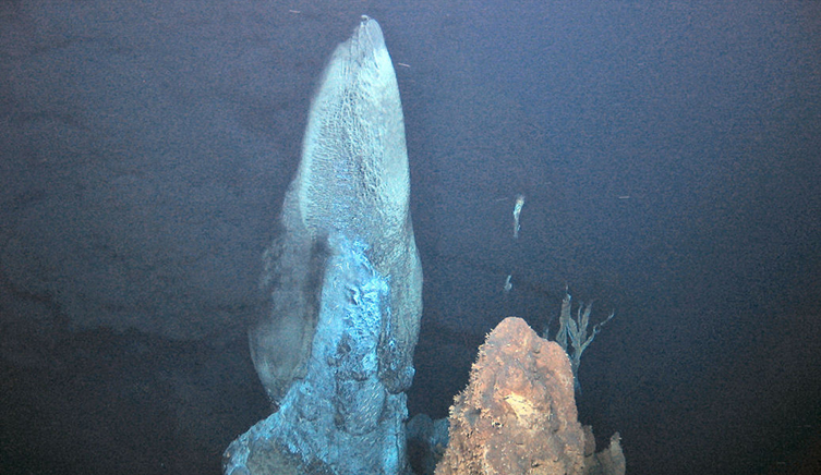 Hydrothermal vents with smoke in the water around them