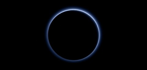 Pluto surrounded by a blue haze
