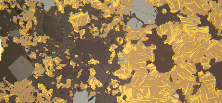 Thin section view of a rock containing tin and indium