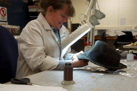 Sarah repairing ice axe holes to a hat Photo 1.jpg