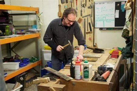 Martin repairing boxes.jpg