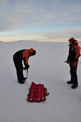 Drilling a hole to measure ice thickness (Custom).jpg