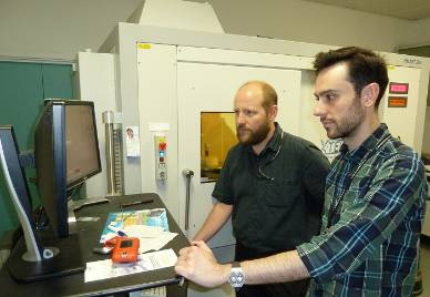 Thomas Simonsen and Daniel Martin-Vega operating Micro-CT scanner.jpg