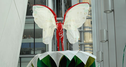 Butterfly emerging from the huge white flower at the royal event
