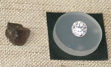 The raw mineral taaffeite alongside the cut gem.