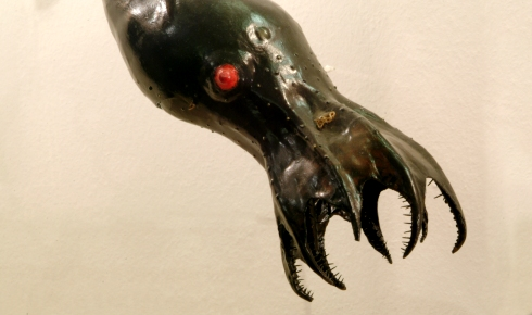 The red eyes and jet-black skin of a vampire squid.