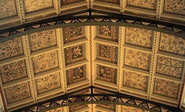 Intricately painted ceiling panels in Hintze Hall.