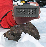 Collecting meteorites in Antarctica © Ralph Harvey