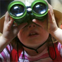 A child using binoculars