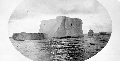 A photo of an iceberg floating in the cold southern ocean, taken from HMS Challenger.