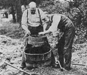 Charles Dawson and Arthur Smith Woodward sieving excavated material at Piltdown in Sussex