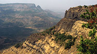 Basalt rock outcrops in India formed by the Deccan Trap volcanic eruptions
