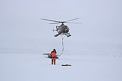 Deploying the first equipment on the floe before the ship could reach it © David N Thomas
