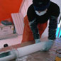 Members of the British Antarctic Survey recovering an ice core © British Antarctic Survey