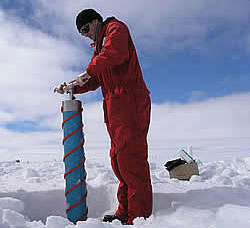 A scientist takes ice samples using a muscle-powered ice corer © David N Thomas