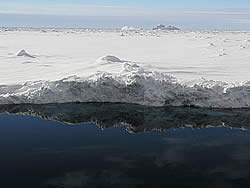 Reflection of the ice floe in the water © David N Thomas