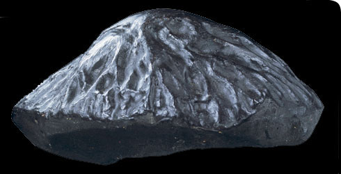 The conical shape of this meteorite points in the direction of travel.