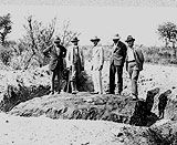 Scientists with the Hoba meteorite which fell in Namibia in 1920 © W. T Gordon.