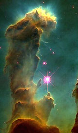 A pillar of dust and gas in the Orion Nebula.
