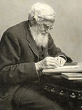 Photograph of Alfred Russel Wallace writing
