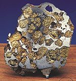 A polished piece of pallasite.