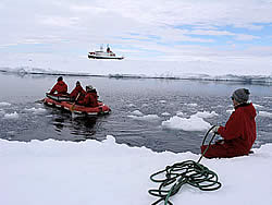 Using a paddle and boat to get to the sampling site © David N Thomas