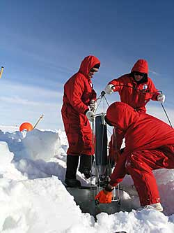 Deploying a trap 50m under the ice to collect particles falling from ice above © David N Thomas