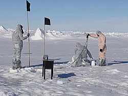 In order not to contaminate the ice, some researchers have to wear snowman suits © David N Thomas