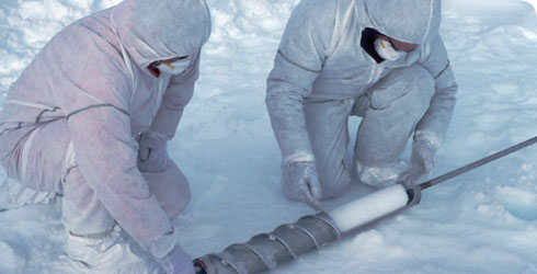 A member of the British Antarctic Survey taking an ice core © British Antarctic Survey