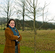 Artist Tania Kovats beside one of the 200 saplings planted at Longleat Estate in Wiltshire