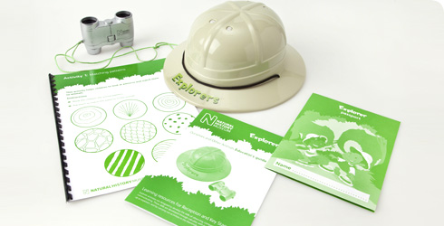 Photograph showing contenets of Explorer packs - activity books, binoculars, explorers hat