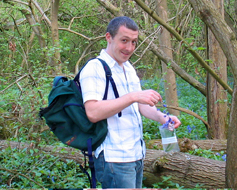 Steve Ansell collecting British native bluebell Hyacinthoides non-scripta
